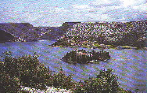 THE FAMOUS VISOVAC MONASTERY ON THE KRKA RIVER, FOUNDED IN 1445 BY BOSNIAN FRANCISCANS FROM KRESEVO, MIDDLE BOSNIA; SHELLED BY THE SERBS IN 1991