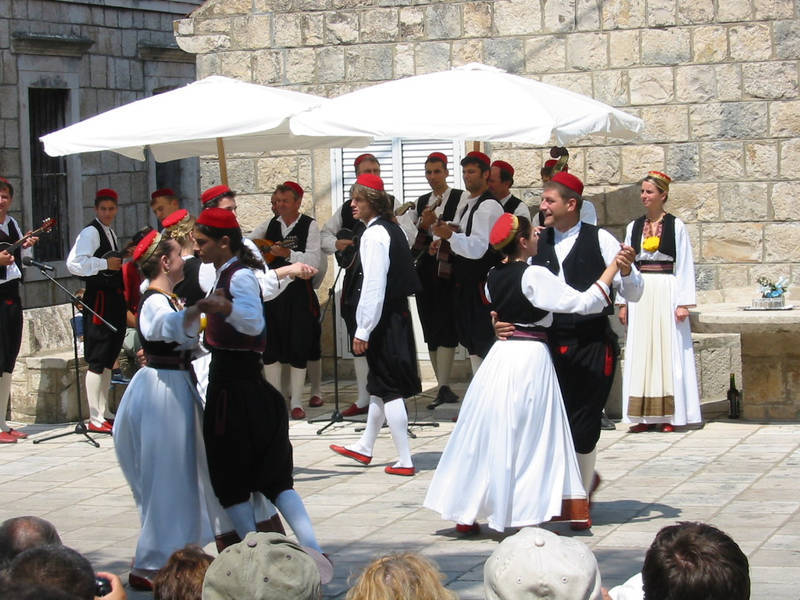 "FOLK DANCERS IN ČILIPI (DALMATIA)  IN DALMATIA, ONE OF THE MOST POPULAR DANCE IS THE LINĐO, FROM DUBROVNIK AND SOUTHERN DALMATIA.      * LINĐO     * POTKOLO - LINE DANCE DONE TO TAMBURICA     * POSKACICA - A COUPLE DANCE DONE TO THE LIJERICA     * NEMIGUSA - A ""WINKING"" COUPLE DANCE     * SELJANICA - POPULAR     * VRLIČKO KOLO - FROM THE TOWN OF VRLIKA     * BAŠKA J' MALO SELO - FROM THE VILLAGE OF BASKA ON KRK ISLAND     * LIPA LI JE RUMEN ROŽICA - FROM THE ISLAND OF MURTER     * DUBRAVAČKO KOLO - POSKOČICA - MERRY DANCE FROM THE DUBROVNIK COUNTRYSIDE     * DUBRAVAČKO KOLENDA - A DUBROVNIK CAROL"