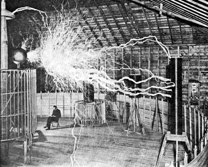 PUBLICITY PICTURE OF A PARTICIPANT SITTING IN HIS LABORATORY IN COLORADO SPRINGS WITH HIS -MAGNIFYING TRANSMITTER- GENERATING MILLIONS OF VOLTS. THE ARCS ARE ABOUT 7 METERS (23 FT) LONG. (TESLA'S NOTES IDENTIFY THIS AS A MULTIPLE EXPOSURE PHOTOGRAPH.) - NIKOLA TESLA  BORN 	10 JULY 1856 (1856-07-10) SMILJAN (CROATIAN MILITARY FRONTIER) (TODAY CROATIA) DIED 	7 JANUARY 1943(1943-01-07) (AGED 86) HOMELAND: CROATIAN - FIELDS 	MECHANICAL AND ELECTRICAL ENGINEERING