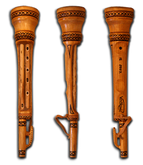 WHAT IS SPECIFIC TO THE PLAYING OF A DUDA IS ITS VIBRATING. DUDA PLAYERS ACHIEVE THIS VIBRATION BY SHAKING THEIR HAND OVER THE BAG, RHYTHMICALLY TAPPING WITH THEIR FINGERS ON THE LOWER HOLES OF THE CHANTER, BY SHAKING THEIR ENTIRE BODY, OR BY JUMPING. PLAYING THE DUDA IN THIS WAY IS VERY UNIQUE AND UNUSUAL –AS VIBRATING AS THE HILLY LANDSCAPES WHERE PEOPLE USED TO PLAY THIS INSTRUMENT.  TO THE LEFT IS A DUDA MADE OF CHERRY WOOD WITH A DIPLICA MADE OF REED INSERTED.  THE FOUR-PART DUDA HAS ALMOST COMPLETELY DISAPPEARED FROM CROATIAN FOLKLORE TRADITION