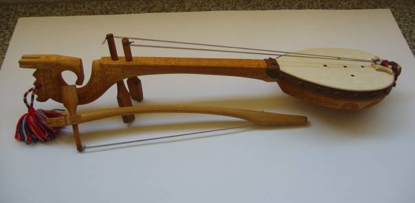 GUSLE - CROATIAN FOLK INSTRUMENT  GUSLE - AN ANCIENT FOLK INSTRUMENT OF CROATIAN PEOPLE USED BY GUSLE PERFORMERS TO RECITE OR SING EPIC POEMS.