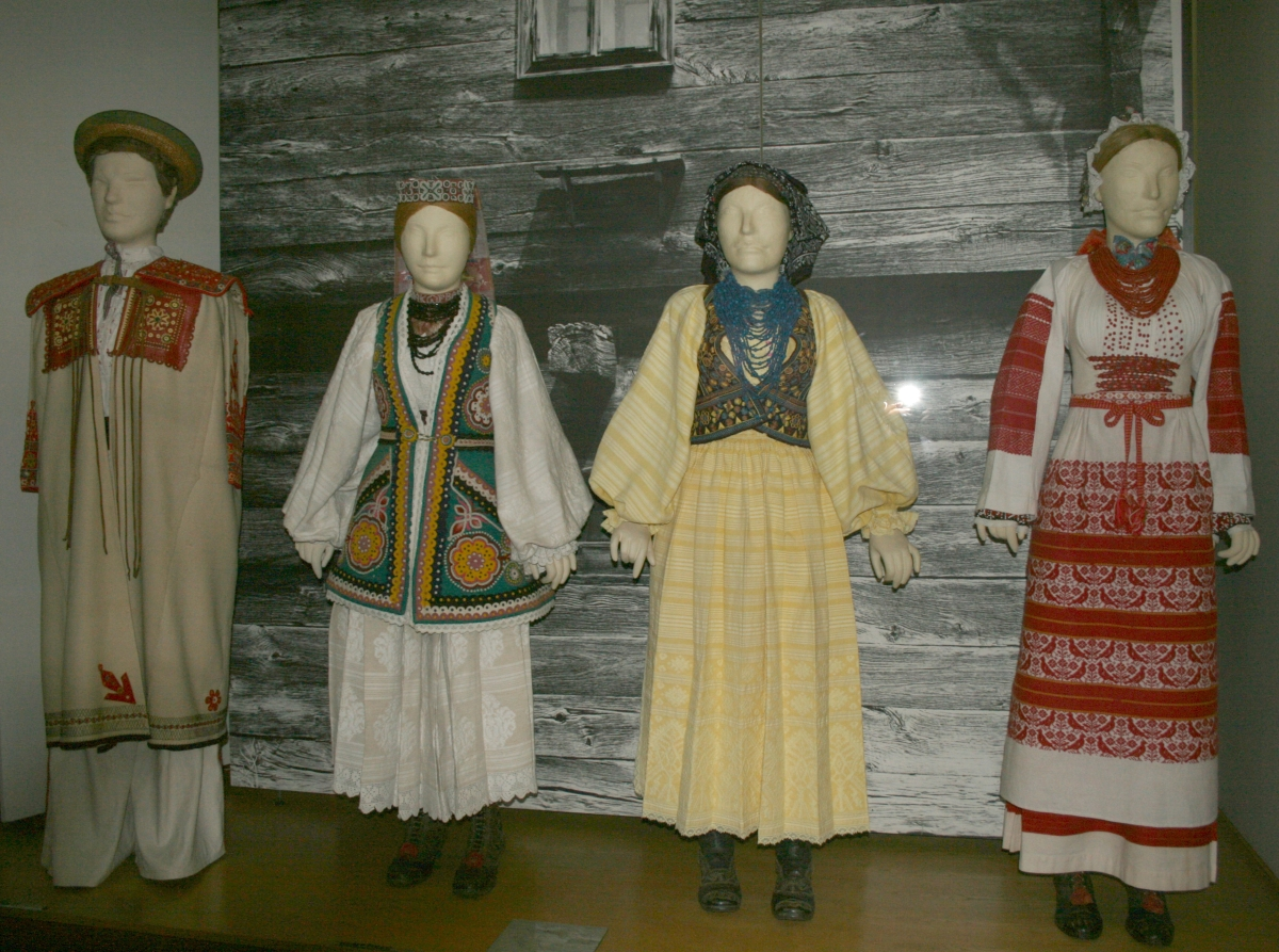 MEĐIMURJE, ZAGORJE AND ZAGREB REGION   CROATIAN NATIONAL DRESS FROM THE VICINITY OF ZAGREB (STUPNIK, REMETINEC, BREZOVICA, LOMNICA)  CROATIAN NATIONAL DRESS FROM MEĐIMURJE    MEĐIMURJE, ZAGORJE AND ZAGREB ARE ALL LOCATED IN THE NORTH, AND ARE THEREFORE INFLUENCED BY THE CONTINENTAL STYLE. WHITE GARMENTS ARE TYPICAL FOR THE CONTINENTAL REGION, BUT EACH HAS ITS OWN DECORATIVE SCARVES, SHAWLS, APRONS, AND JEWELLERY. RED IS THE MOST POPULAR COLOR, ESPECIALLY IN ZAGORJE, AND THE APRONS AND VESTS WORN BY THE MEN AND WOMEN ARE RED WITH ELABORATE STITCHING AND EMBROIDERY, MOSTLY WITH GOLD THREAD. WOMEN WEAR COLORFUL SHAWLS AND KERCHIEFS WHICH ARE USUALLY RED WITH FLOWER DESIGNS. THE SECOND MOST POPULAR COLOR IS BLACK, WHICH COULD HAVE GOLD OR WHITE EMBROIDERY, OR NONE AT ALL.  VERY OFTEN, THE MEN AND WOMEN WOULD NOT WEAR ANY APRONS OR SHAWLS, AND THEIR COSTUMES WOULD MOSTLY CONSIST OF THEIR WHITE GARMENTS, WHICH THEY MAY STITCH A BORDER OF COLOR AT THE ENDS, OR ADD A SASH (TKANICA) FOR SOME COLOR.  HATS ARE AN IMPORTANT PART OF A MALE'S COSTUME, AND CAN COME IN TWO FORMS: THE TRADITIONAL PANNONIAN HAT (ŠKRLAK) IS BLACK AND DOME-SHAPED, WITH A RED WOOL BAND EMBROIDERED WITH MULTI-COLORED THREAD AND WHITE AND GOLD DOTS ATTACHED, OR THE BLACK FELT BOX-HAT (ŠEŠIR) FOLDED INTO A FLAT BOW AT THE BACK WITH A GROSGRAIN RIBBON TIED AROUND THE BODY. OVER THE GROSGRAIN RIBBON, RED, WHITE AND BLUE STRINGS ARE OFTEN TIED AROUND THE HAT (E.G. THE CROATIAN TRI-COLOR).